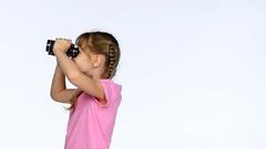 Little child girl looking through binoculars Stock Footage