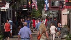 Tourists walk in St George Street, St Augustine, Florida, USA Stock Footage
