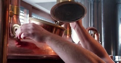 Craft brewery equipment 4k close-up video. Beer production: hand close vats tank Stock Footage