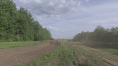 Aerial dirt bike low flight as rider zoom by over jump  motocross 4k Stock Footage