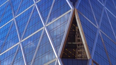 Corporate skyscraper exterior background close up glass facade blue sky windows Stock Footage