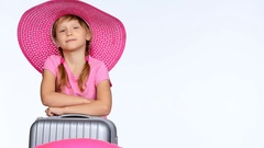 Little girl tourist with travel suitcase showing thumb up sign Stock Footage