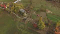 Aerial farm animals and barn spinning descent 4k Stock Footage