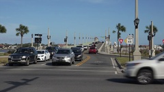 Horse carriage passes Bridge of Lions, St Augustine, Florida, USA Stock Footage