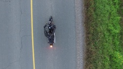 Aerial motorcycle harley davidson takes off above rising view 4k Stock Footage