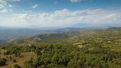 Aerial Beautiful Countryside Hilly Landscape Wide Mountains Forest Remote Sunny Stock Footage