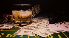 Flying dollars on gaming table with cards,chips whiskey.win,slow motion 240 fps Stock Footage