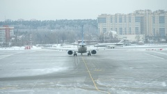 Aircrafts of different airlines moving on runways at Vnukovo airport Stock Footage