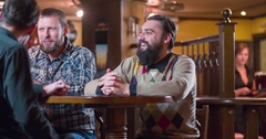 Waiter brings beer glasses men 4k video on pub bar restaurant. Male friends fun Stock Footage