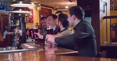 Friends group talks drinks beer at pub bar 4k close-up video. Men toast cheers Stock Footage