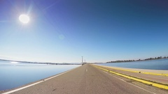 Pov Vehicle Drive Narrow Jetty Road Fishing Lagoon Car Blue Sky Sunny Greece Stock Footage