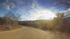 Vehicle Drive Hilly Car Travel Remote Nature Road Blue Sky Sunny Sunlight Pov Stock Footage