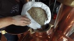 Barley malt grain pouring falling vats tank beer brewing HD POV video Stock Footage