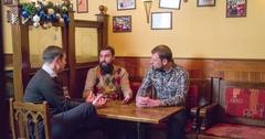 Waiter brings beer glasses men 4k video pub bar restaurant. Friends toast cheers Stock Footage