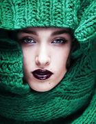 Young pretty woman in sweater and scarf all over her face close Stock Photos