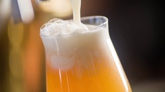 Craft beer pouring to glass in pub bar HD slow-motion video. Lager ale cask Stock Footage