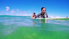 Beautiful Surfer Girls Smiling Happy Floating On Surfboard In The Ocean Blue Sky Stock Footage