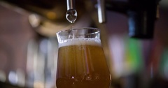 Craft beer pouring glass pub bar HD slow-motion video. Lager ale dunkel cask Stock Footage