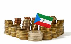 Equatorial Guinea flag waving with stack of money coins Stock Photos