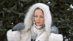 A Beautiful Fashion Model Smiling and Looking At Camera. Drifting snow in the Stock Footage