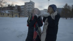 Girls fool around in the street in winter Stock Footage