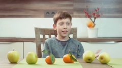 Little boy juggling with fruit Stock Footage