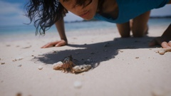 The island of Bali. Beach. Arthropods. Brunette on the beach. She saw Stock Footage