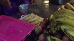 Thailand Hua Hin food market cook preparing banana loti Stock Footage