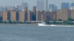 Yacht, Speed Boat on East River with Manhattan Skyline in the Background Stock Footage