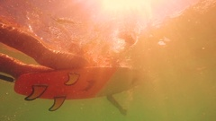 Attractive Surfboarder Underwater At The Golden Hour Paddling, Surfing, Swimming Stock Footage