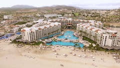 Aerial shot of tropical beachfront resort, hotel - San Jose del Cabo, Mexico Stock Footage