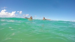 Two Active Surfers Swimming Paddling Towards The Camera In Slow Motion Stock Footage