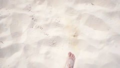 Human legs, walking on the white sand beaches of the Caribbean coast Stock Footage
