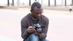 African American Photographer Reviewing Footage in DSLR Camera Stock Footage