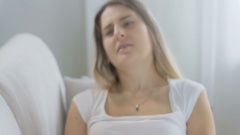 Sick woman measuring temperature and getting upset after looking at thermometer Stock Footage