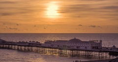 Time lapse panning view of a sunset on the beach in Brighton. Day to night Stock Footage