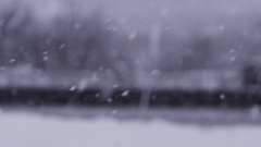 Cars navigating a snow storm with slow motion snowflakes Stock Footage