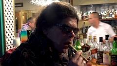 Guy at the night bar lights a cigar. Cuba Stock Footage