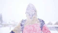Young girl in bright winter clothes having fun outdoor in winter forest under Stock Footage