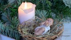Extinguishing christmas candle Stock Footage