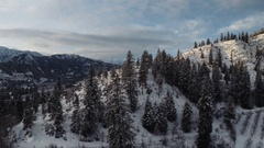 Aerial Winter Landscape Through Moutains Over Rural Valley Stock Footage