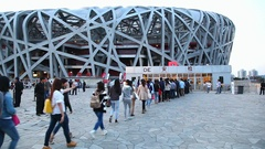 People wait for sport game in Olympic Stadium Bird's Nest in Beijing, China Stock Footage