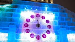 23-59 on Christmas clock in ice. New Year moment Stock Footage