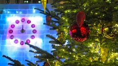 The first minute of the New Year on Christmas clock and fir tree in Moscow Stock Footage