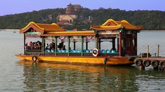 Ancient boat and the view of Summer Palace and Kunming Lake in Beijing, China Stock Footage
