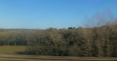 Point of view from train of the English countryside Stock Footage