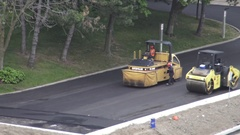 Asphalt paver finisher and double drum road roller machine Stock Footage