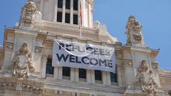 Refugees welcome poster in Madrid Stock Footage