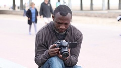 Photographer Reviewing Footage in DSLR Camera Stock Footage