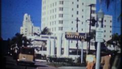 Miami beach street scene with traffic & hotel pool, 3891 vintage film home movie Arkistovideo